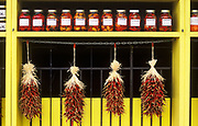 Image of a storefront filled with chili peppers and local foodwares in Fredericksburg, Texas, America Southwest by Randy Wells