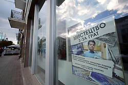 October 4, 2018 - Kyiv, Ukraine - A poster announces the Art From Behind Bars exhibition showcasing drawings of Ukrinform's Paris-based correspondent Roman Sushchenko made in Russia's Lefortovo Prison, Kyiv, capital of Ukraine, October 4, 2018. As reported, Roman Sushchenko was illegally detained on September 30, 2016 in Moscow while on a private trip. On October 7, 2016, he was charged with ''espionage''. Russia's FSB said that Sushchenko was a member of the Main Intelligence Directorate of the Ukrainian Defence Ministry. The latter denied this allegation. On June 4, the Moscow City Court sentenced Roman Sushchenko to 12 years in a high-security prison for alleged espionage. The Supreme Court of Russia upheld the verdict on September 12. Ukrinform. (Credit Image: © Pavlo_bagmut/Ukrinform via ZUMA Wire)