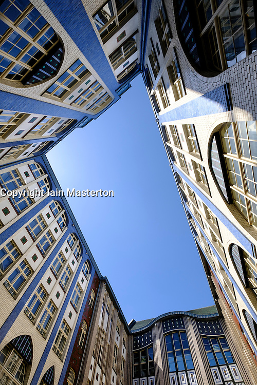 Looking up at ornate old buildings from courtyard at Hackesche Hofe in Mitte Berlin Germany