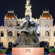 Ho Chi Minh statue in front of city hall. Ho Chi Minh City Hall was built in the early 20th Century by the French colonial government as Saigon's city hall. It's also known as Ho Chi Minh City People's Committee Head office, in French as Hôtel de Ville de Saigon, and in Vietnamese as Tr? s? ?y ban Nhân dân Thành ph? H? Chí Minh.