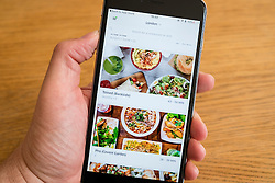 UberEats app for restaurant delivery services in London show on an iPhone 6 smartphone
