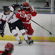 Nora Maclaine, (left), UConn and Sammy Davis, Boston University, clash during the UConn Vs Boston University, Women's Ice Hockey game at Mark Edward Freitas Ice Forum, Storrs, Connecticut, USA. 5th December 2015. Photo Tim Clayton
