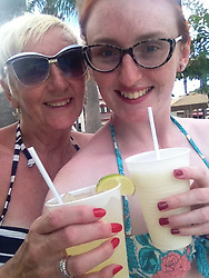 Emma with her Mum Pat  in 2014 on holiday in Florida. Emma McCauley, 26, of Barking, East London had to undergo a double mastectomy just weeks after losing her mother to breast cancer, discovering she herself had breast cancer and keeping it a secret whilst caring for her mother in her final weeks. London, July 31 2019.