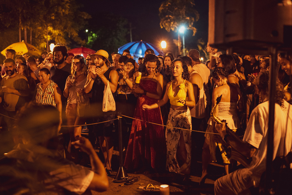 Paraty, Brazil - March 18, 2019: Locals and tourists alike enjoy live music at night in a public square in Paraty, a colonial town in Rio de Janeiro State, Brazil.