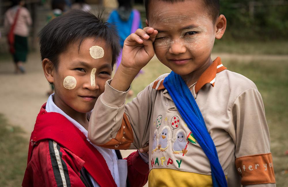 INLE LAKE, MYANMAR - CIRCA DECEMBER 2013: Burmese kids in the Sankar village (or Samka ). A small village located in the south of Inle Lake.