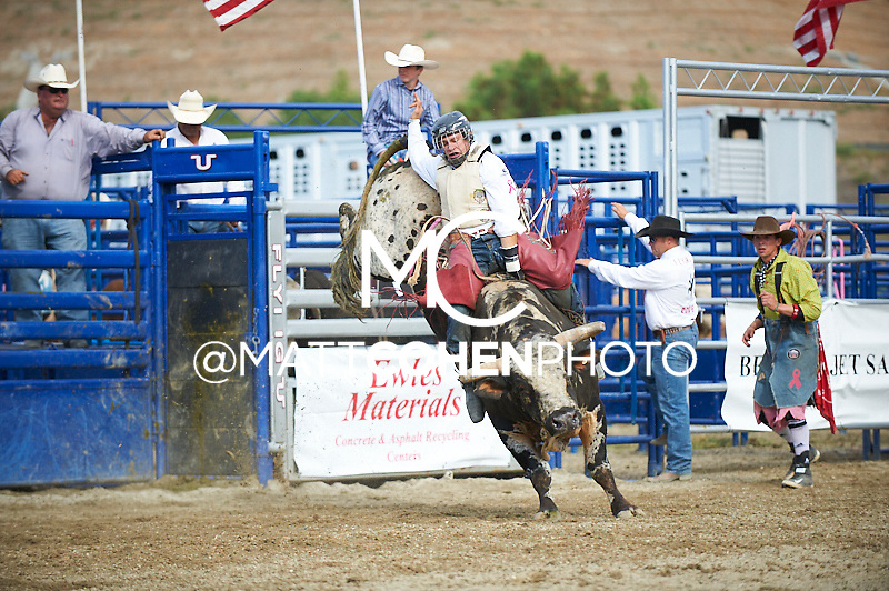 Bull rider Dustin Bowen of Fredricksburg, PA rides 305/8 MJ Timber Wolf at the Rancho Mission Viejo Rodeo in San Juan Capistrano, CA.  <br /> <br /> <br /> UNEDITED LOW-RES PREVIEW<br /> <br /> <br /> File shown may be an unedited low resolution version used as a proof only. All prints are 100% guaranteed for quality. Sizes 8x10+ come with a version for personal social media. I am currently not selling downloads for commercial/brand use.