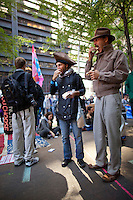 Christopher Fox of Tampa, FL, left, and Laughlin Clarke of Japan have lunch in Zuccotti Park during the  Occupy Wall Street Protest in New York...Photo by Robert Caplin.