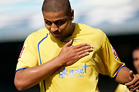 Photo: Mike Greenslade..Cardiff City v Sheffield Wednesday..Coca Cola Championship League..07.04.07..Ninian Park..KO 3pm...Owls striker puts his hand on his club's badge after scoreing the match's first goal at Ninian Pk