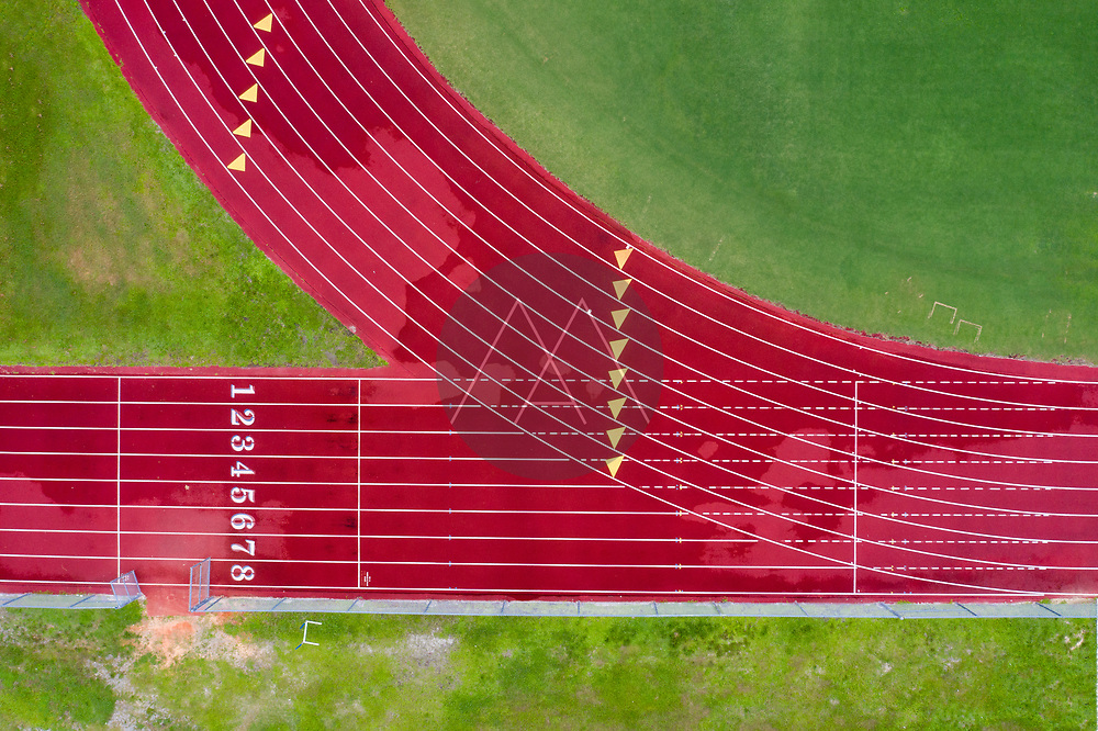 Aerial view of a red running path at Sebastian river high School, Florida, United States.
