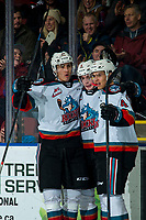 KELOWNA, BC - DECEMBER 30: Alex Swetlikoff #17, Mark Liwiski #9 and Devin Steffler #4 of the Kelowna Rockets celebrates a first period goal against the Prince George Cougars  at Prospera Place on December 30, 2019 in Kelowna, Canada. (Photo by Marissa Baecker/Shoot the Breeze)