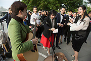 Chinese wedding party of friends and relatives descend upon the South Bank. Here a slightly bemused busker played songs for them and was then given a lot of money. The happy couple who were from Beijing had only been in London for one day, having travelled to the UK just to get married.