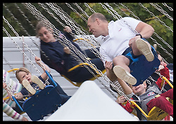June 11, 2017 - Westonbirt, United Kingdom - Image licensed to i-Images Picture Agency. 11/06/2017. Westonbirt, United Kingdom. Mike Tindall has a go on a swing ride with his daughter Mia (left) at the Gloucestershire Festival of Polo at Beaufort Polo Club in Westonbirt, Gloucestershire, United Kingdom. Picture by Stephen Lock / i-Images (Credit Image: © Stephen Lock/i-Images via ZUMA Press)