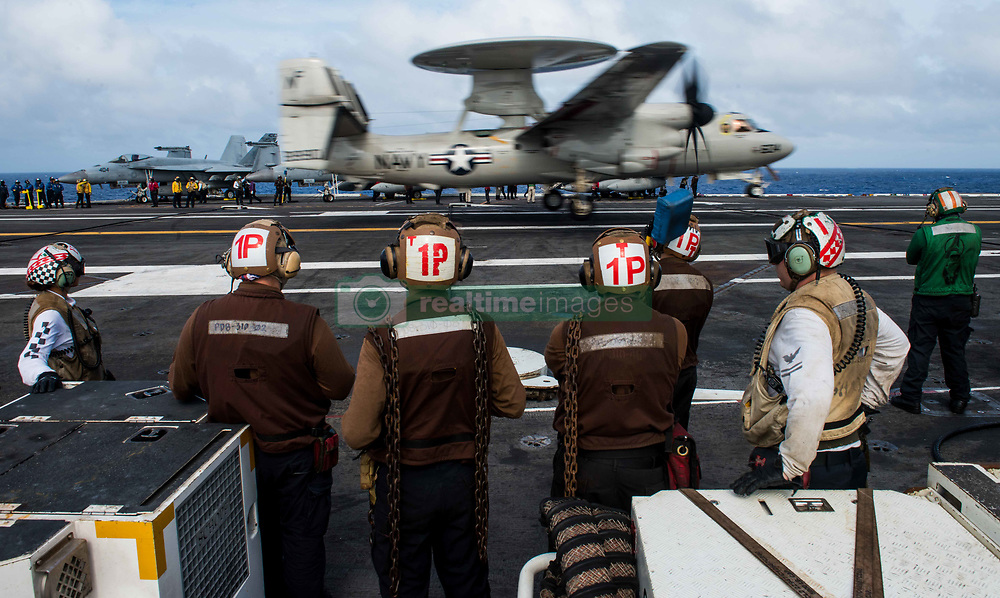 WATERS SOUTH OF JAPAN (August 15, 2018) Sailors observe as an E-2D Hawkeye assigned to Airborne Early Warning Squadron (VAW) 125 lands on the flight deck of the Navy's forward-deployed aircraft carrier, USS Ronald Reagan (CVN 76). Ronald Reagan, the flagship of Carrier Strike Group 5, provides a combat-ready force that protects and defends the collective maritime interests of its allies and partners in the Indo-Pacific region. (U.S. Navy photo by Mass Communication Specialist 2nd Class Kenneth Abbate/Released)180815-N-OY799-0174
