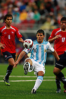 ARGENTINA (ARG) [3] Vs. CHILE (CHI) [0]  at the U-20 Soccer Football WORLD CUP - Canada'07 Semi Final match 19/07/07 in Toronto, Canada.<br /> Here Argentine player AGUERO Sergio between Chilean N*4 GODOY Eric  and N*17 MARTINEZ Hans  <br /> © Gabriel Piko / PikoPress