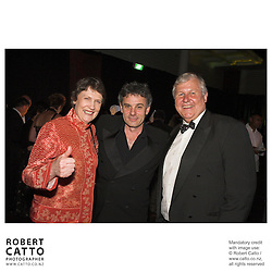 The Right Honourable Helen Clark, Prime Minister of New Zealand, celebrates with director Vincent Ward and producer Don Reynolds at the premiere of the film River Queen, in Wanganui, New Zealand.