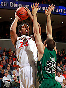 CHARLOTTESVILLE, VA- NOVEMBER 26:  Mike Scott #23 of the Virginia Cavaliers shoots over Daniel Turner #22 of the Green Bay Phoenix during the game on November 26, 2011 at the John Paul Jones Arena in Charlottesville, Virginia. Virginia defeated Green Bay 68-42. (Photo by Andrew Shurtleff/Getty Images) *** Local Caption *** Daniel Turner;Mike Scott