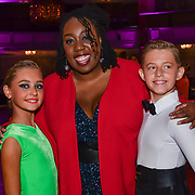 Chizzy Akudolu, Nathan Storey of Strictly School Dancing Ltd and Olivia Smorga of Nice n Easy - Dance Studios in Bournemouth winner of the Paul Killick - Killick Royale Championships 2018 at The Grosvenor House Hotel, London, UK. 7 October 2018.