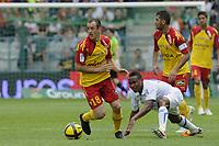 FOOTBALL - FRENCH CHAMPIONSHIP 2010/2011 - L1 - AJ AUXERRE v RC LENS - 24/04/2011 - PHOTO ALAIN GADOFFRE / DPPI - SEBASTIEN ROUDET (RCL)/ KOSSI SEGBEFIA (AJA)