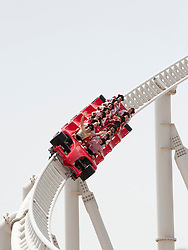Visitors riding world's fastest roller coaster, Formula Rossa, at Ferrari World in Abu Dhabi United Arab Emirates UAE