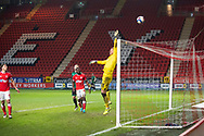 Charlton's Goalkeeper Ben Amos tips the ball over the bar during the EFL Sky Bet League 1 match between Charlton Athletic and Rochdale at The Valley, London, England on 12 January 2021.
