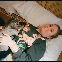 """Lena Dunham releases a photo on Instagram with the following caption: """"My brother @mattpwolf is playing with medium format and caught me in my element- with a hairless animal in an unmade bed at high noon, smiling when tears would suffice. I love this crooked little life I\u2019ve made and I sure hope you\u2019re feeling similarly today."""". Photo Credit: Instagram *** No USA Distribution *** For Editorial Use Only *** Not to be Published in Books or Photo Books ***  Please note: Fees charged by the agency are for the agency's services only, and do not, nor are they intended to, convey to the user any ownership of Copyright or License in the material. The agency does not claim any ownership including but not limited to Copyright or License in the attached material. By publishing this material you expressly agree to indemnify and to hold the agency and its directors, shareholders and employees harmless from any loss, claims, damages, demands, expenses (including legal fees), or any causes of action or allegation against the agency arising out of or connected in any way with publication of the material."""