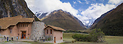 Panoramic view of Salkantay Lodge, with Nevado Humantay and Salkantay mountain (right)  in the distance; Soraypampa, Peru.