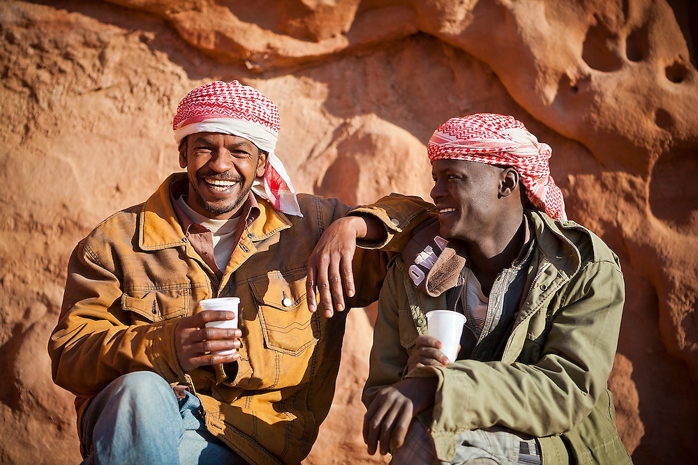 Sudanese Bedouin guides drink tea and relax at the Bedouin Roads camp in Wadi Rum, Jordan.