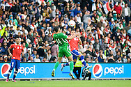 14.09.13. Brondby, Denmark.Alexis Sanchez  (R) of Chile and Salam Shakir (L) of Irak jump for the ball during the international friendly match at the Brondby Stadium in Denmark.Photo: © Ricardo Ramirez