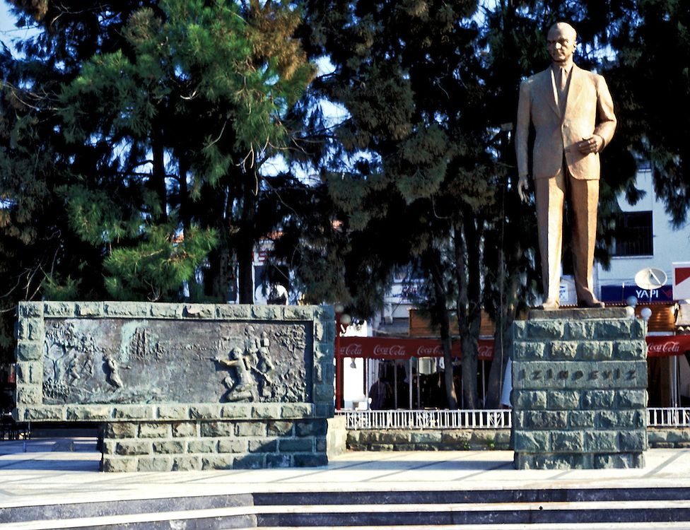 Statue of Ataturk on a war memorial looking over the town square of Ayvalik