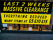 Clearance sale of fashion clothing, Leicester, UK. Signs of economic downturn / recession.