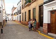 Group of women talking in the street, village of Alajar, Sierra de Aracena, Huelva province, Spain