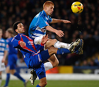 Photo: Daniel Hambury.<br />Crystal Palace v Reading. Coca Cola Championship.<br />20/01/2006.<br />Palace's Jobi McAnuff and Reading's Steve Sidwell battle for the ball.
