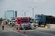 Emergency crews work to clear a multi car accident on LBJ Freeway near Marsh Lane after a dump truck jumped the concrete barrier in Dallas on Tuesday, September 10, 2013. (Cooper Neill/Special Contributor)