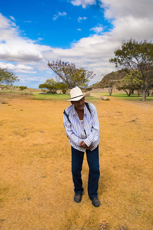 An old man offering some handcraft at Monte Alban ruins.