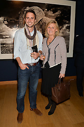 FREDDIE TUCKER and his mother BEVERLEY ROBB at the Christie's Conservation Lectures in aid of Tusk held atChristie's, 8 King Street, London on 30th April 2014.
