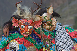 Masked dancers at Pentecostes Festival held annually in May, Ollantaytambo, Peru, South America