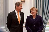 13 JAN 2011, BERLIN/GERMANY:<br /> Guido Westerwelle (L), FDP, Bundesaussenminister, und Angela Merkel (R), CDU, Bundeskanzlerin, im Gespraech, Neujahrsempfang des Bundespraesidenten, Schloss Bellevue<br /> IMAGE: 20110113-01-091<br /> KEYWORDS: Bundespräsident, Gespräch