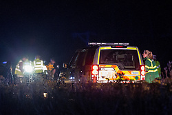 © Licensed to London News Pictures . 21/07/2014 . Nottinghamshire , UK . An ambulance at the scene . Police , fire crew and ambulances on the A1 road in Ranby yesterday morning (21st July 2014) following a fatal multi vehicle accident . Leroy and Sheila Carrington (aged 68 and 58) died at the scene when the Peugot 206 they were driving collided with a Vauxhall Astra . Roderick Franks (58) , who was a passenger in the Astra , died in hospital , following the crash . The road was closed in both directions whilst police investigated the scene .  Photo credit : Joel Goodman/LNP