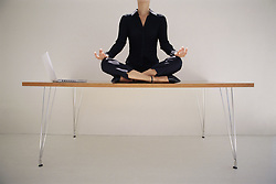 Dec. 05, 2012 - Woman meditating on desk (Credit Image: © Image Source/ZUMAPRESS.com)