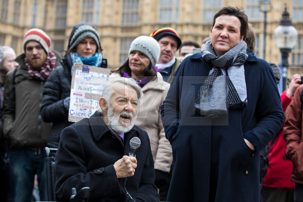 © Licensed to London News Pictures. 23/02/2018. London, UK. Labour MP Paul Flynn (L) speaks to protesters opposite Parliament in support of the legalisation of cannabis for medicinal use while MPs debate the issue in The House of Commons. Photo credit: Rob Pinney/LNP