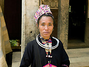Portrait of a Ko Pala ethnic minority woman wearing her traditional clothing at Pak Nam Noi market, Phongsaly province, Lao PDR. One of the most ethnically diverse countries in Southeast Asia, Laos has 49 officially recognised ethnic groups although there are many more self-identified and sub groups. These groups are distinguished by their own customs, beliefs and rituals. Details down to the embroidery on a shirt, the colour of the trim and the type of skirt all help signify the wearer's ethnic and clan affiliations.