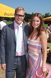 SEBASTIAN PEARSON and his wife AMANDA he is the son of Viscount Cowdray at the Veuve Clicquot sponsored Gold Cup Final or the British Open Polo Championship held at Cowdray Park, West Sussex on 17th July 2005.<br /><br />NON EXCLUSIVE - WORLD RIGHTS
