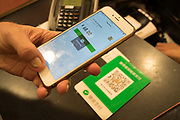 Buying a product with Wechat cashless application on your mobile telephone