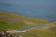 Nederland, Groningen, Gemeente Eemsmond, 08-09-2009; Noordpolderzijl met gemaal en uitwaterende sluis. In de Waddenzee het Groninger Wad met landaanwinning. Bij het op deltahoogte brengen van de zeedijk is de oude sluis dichtgemetseld en deze maakt nu deel uit van het landart mozaiek..Noordpolderzijl pumping station ans sluices. In the Wadden Sea the Groninger Wad with land reclamation. When seawall was strengthened the old lock disappeared, it is now part of the landart mosaic..luchtfoto (toeslag); aerial photo (additional fee required); .foto Siebe Swart / photo Siebe Swart