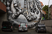 A huge street painting, Crocodile in a car park by the UK artist Phlegm, on 20th September 2019 in the trendy neighbourhood of Grunerlokka, Oslo, Norway, which is full of colourful street paintings. Once outlawed and stigmatized, street art has become more than welcome in Oslo over the last decade, turning the city into a blossoming outdoor gallery sprinkled with both local and international works of art.
