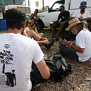 """Occupants of """"Camp Romney"""" prepare for a protest parade during the Republican National Convention in Tampa, Fla. on Wednesday, August 29, 2012. (AP Photo/Alex Menendez)"""