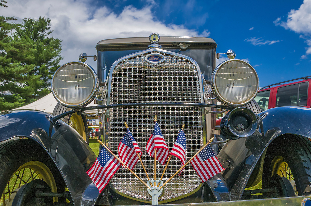 Antique Ford car decorated with American flags, closeup, New Boston, NH