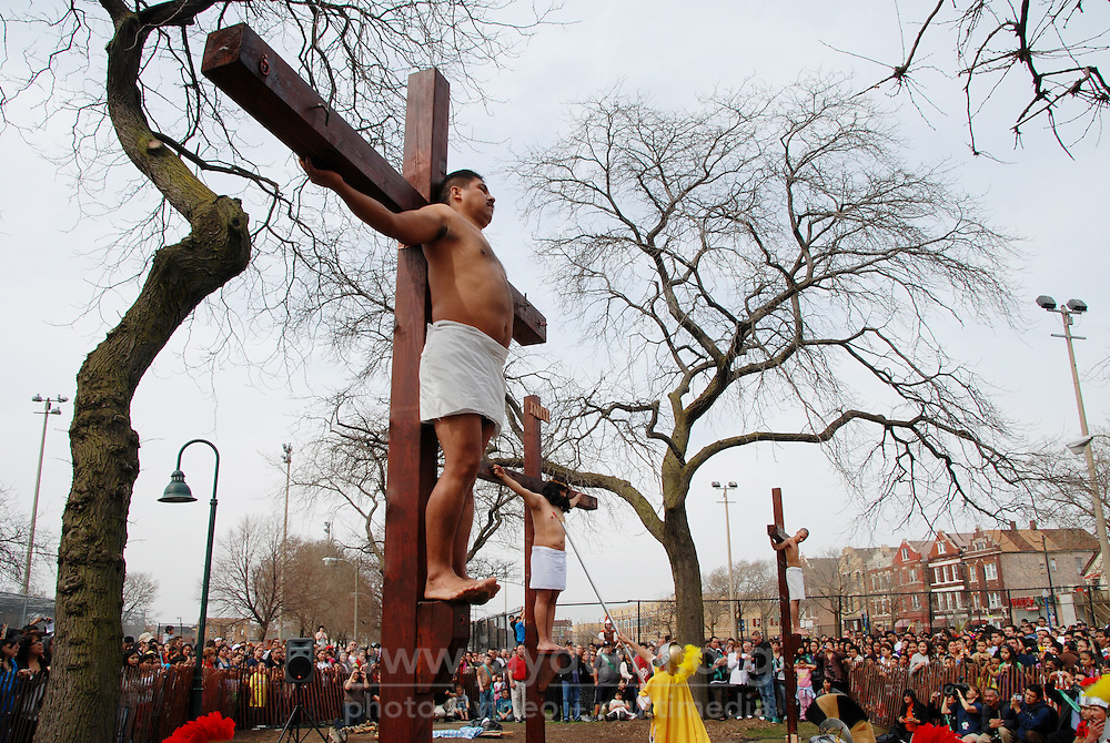 """USA, Chicago, March 28 - April 2, 2010. Salvador Zavala, a 33-year old Mexican carpenter, was chosen from among seven Catholic parishes to play Jesus in the annual """"Via Crucis,"""" a faithful re-enactment of Christ's last hours. Led by Jorge Nieto, who himself played Jesus in 1987, and his wife Carmen, the Way of the Cross Committee takes great pains to rehearse every step carefully, counting on the devotion and patience of its Chicago members to ensure the event's success. Beginning at the Providence of God Parish with Pilate's condemnation of Christ, the three-hour Good Friday procession follows the """"Stations of the Cross"""" along Pilsen's 18th St, culminating in Christ's crucifixion and entombment, marked with a service at St. Adalbert's."""