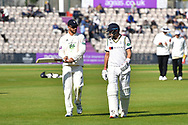 Joe Root of Yorkshire talks about his bat with Aiden Markram of Hampshire as they walk back to the pavilion for tea during the Specsavers County Champ Div 1 match between Hampshire County Cricket Club and Yorkshire County Cricket Club at the Ageas Bowl, Southampton, United Kingdom on 11 April 2019.