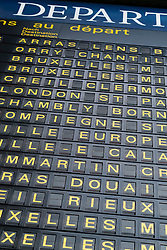 Detail of destinations on departures board at Gare du Nord railway station in Paris France